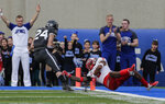 New Mexico safety Michael Sewell Jr. (5) unsuccessfully tries to stop Air Force running back Kadin Remsberg (24) from scoring a touchdown during the first half of an NCAA college football game, Saturday, Nov. 10, 2018, at Air Force Academy, Colo. (AP Photo/Jack Dempsey)