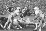 FILE - In this Jan. 1, 1973, file photo, Southern California fullback Sam Cunningham (39 dives into the end zone for his fourth touchdown against Ohio State during the Rose Bowl NCAA college football game in Pasadena, Calif. Cunningham, an All-American fullback at Southern California whose performance against Alabama was credited for helping integrate football in the Deep South before he went on to a record-setting career with the New England Patriots, died Tuesday, Sept. 7, 2021, at his home in Inglewood, Calif., according to USC. He was 71. (AP Photo/File)