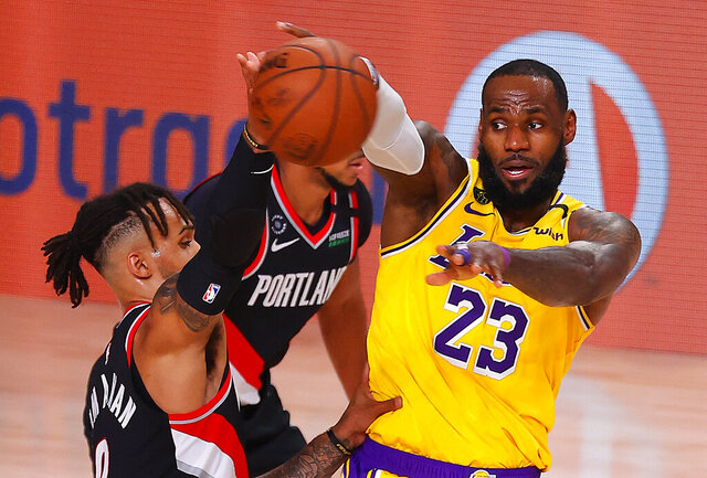 LeBron James #23 of the Los Angeles Lakers drives the ball against Gary Trent Jr. #2 of the Portland Trail Blazers during the first half of Game 1 of an NBA basketball first-round playoff series, Tuesday, Aug. 18, 2020, in Lake Buena Vista, Fla. (Mike Ehrmann/Pool Photo via AP)