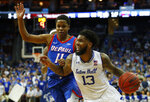 Seton Hall's Myles Powell (13) drives to the basket against DePaul's Charlie Moore (11) during the second half of an NCAA college basketball game Wednesday, Jan. 29, 2020, in Newark, N.J. (AP Photo/Noah K. Murray)