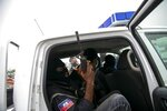 Former paramilitary leader Emmanuel Constant is loaded into a police vehicle after being detained by Haitian police at his arrival to the Toussaint Louverture International Airport in Port-au-Prince, Haiti, Tuesday, June 23, 2020. Human rights groups have accused Constant, who has just been deported from the US, of killing and torturing Haitians when he became the leader of the Front for the Advancement and Progress of Haiti after President Jean-Bertrand Aristide's presidency was toppled in 1991. (AP Photo/Dieu Nalio Chery)