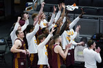 Loyola of Chicago players celebrate after beating Illinois in a college basketball game in the second round of the NCAA tournament at Bankers Life Fieldhouse in Indianapolis Sunday, March 21, 2021. Loyola upset Illinois 71-58. (AP Photo/Mark Humphrey)
