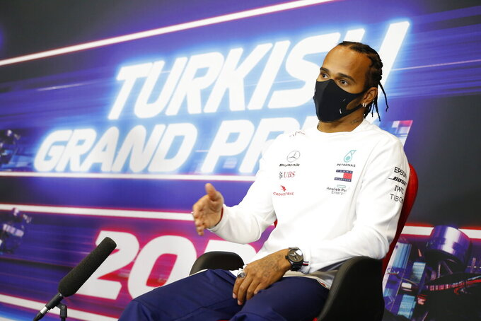 Mercedes driver Lewis Hamilton of Britain talks during a press conference at the Istanbul Park circuit racetrack in Istanbul, Thursday, Nov. 12, 2020, ahead of the Formula One Turkish Grand Prix that will take place on Sunday. (Antonin Vincent/Pool via AP)