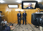 FILE - In this May 14, 2018, file photo, Sapporo Mayor Katsuhiro Akimoto, center left, and Tsunekazu Takeda, center right, an IOC member and head of the Japanese Olympic Committee, speak to the media after their meeting in Tokyo. The Japanese city of Sapporo is expected to withdraw from bidding for the 2026 Winter Olympics, leaving four candidates as the International Olympic Committee finds it increasingly difficult to find hosts - particularly for the Winter Olympics. A city official says Deputy Mayor Takatohsi Machida and Japanese Olympic Committee President Tsunekazu Takeda will meet IOC President Thomas Bach on Monday, Sept. 17, 2018.(AP Photo/Koji Ueda, File)
