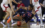 Auburn forward Isaac Okoro, center, drops while chasing the ball against Davidson forward Bates Jones, left, and guard Carter Collins during the first half of an NCAA college basketball game at the Veterans Classic Tournament, Friday, Nov. 8, 2019, in Annapolis, Md. (AP Photo/Julio Cortez)