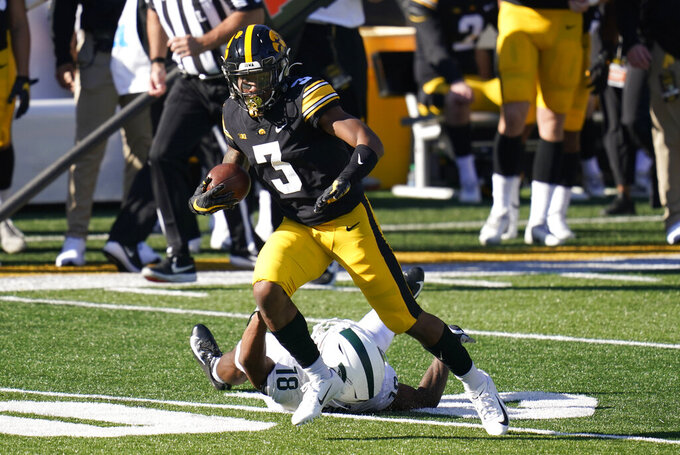 FILE - Iowa wide receiver Tyrone Tracy Jr. (3) runs from Michigan State cornerback Kalon Gervin (18) after catching a pass during the second half of an NCAA college football game in Iowa City, Iowa, in this Saturday, Nov. 7, 2020, file photo. Tracy Jr. wants to establish himself as the leader of Iowa's young receiving corps. (AP Photo/Charlie Neibergall, File)