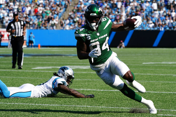 New York Jets wide receiver Corey Davis runs against the Carolina Panthers during the second half of an NFL football game Sunday, Sept. 12, 2021, in Charlotte, N.C. (AP Photo/Jacob Kupferman)