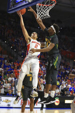 Florida guard Andrew Nembhard (2) makes a shot past Baylor forward Flo Thamba (0) during the first half of an NCAA college basketball game Saturday, Jan. 25, 2020, in Gainesville, Fla. (AP Photo/Matt Stamey)