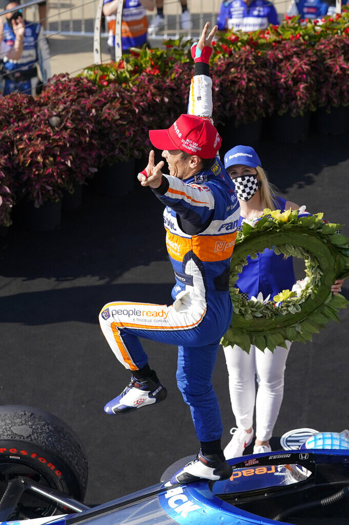 Takuma Sato, of Japan, celebrates after winning the Indianapolis 500 auto race at Indianapolis Motor Speedway, Sunday, Aug. 23, 2020, in Indianapolis. (AP Photo/Darron Cummings)