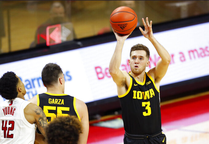 Iowa guard Jordan Bohannon (3) shoots against Rutgers during the first half of an NCAA college basketball game in Piscataway, N.J., Saturday, Jan. 2, 2021. (AP Photo/Noah K. Murray)