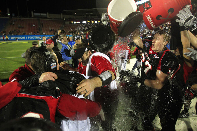 FILE - In this Jan. 7, 2011, file photo, Eastern Washington players douse the coaching staff after defeating Delaware 20-19 winning the the FCS Championship NCAA college football game in Frisco, Texas. Before North Dakota State made Fargo to Frisco an annual trip, Eastern Washington won the first FCS championship game played in North Texas. That was eight years ago. (AP Photo/LM Otero, File)