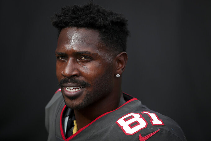 FILE - Tampa Bay Buccaneers wide receiver Antonio Brown (81) smiles while entering the tunnel at halftime during an NFL football game against the Atlanta Falcons in Tampa, Fla., in this Sunday, Jan. 3, 2021, file photo. Receiver Antonio Brown has agreed to return to the Tampa Bay Buccaneers on a one-year contract that could be worth up to $6.5 million, including incentives, a person familiar with the deal told The Associated Press. The person spoke on the condition of anonymity Wednesday, April 28, 2021,  because the agreement, which includes a $2 million signing bonus and a little more than $3 million guaranteed, had not been announced by the reigning Super Bowl champions. (AP Photo/Kevin Sabitus, File)
