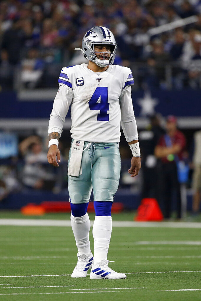 Dallas Cowboys quarterback Dak Prescott (4) stands on the field in the first half of an NFL football game against the Buffalo Bills in Arlington, Texas, Thursday, Nov. 28, 2019. (AP Photo/Ron Jenkins)