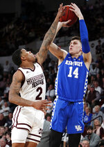 Kentucky guard Tyler Herro (14) shoots a basket over Mississippi State guard Lamar Peters (2) during the second half of an NCAA basketball game in Starkville, Miss., Saturday, Feb. 9, 2019. Kentucky won 71-67. (AP Photo/Rogelio V. Solis)