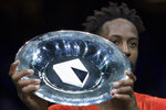 Gael Monfils of France holds the trophy as he celebrates winning against Stan Wawrinka of Switzerland in three sets, 6-3, 1-6, 6-2, in the men's singles final of the ABN AMRO world tennis tournament at Ahoy Arena in Rotterdam, Netherlands, Sunday, Feb. 17, 2019. (AP Photo/Peter Dejong)