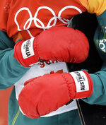 ScottyJames, of Australia, gribs his board with is gloves during the men's halfpipe finals at Phoenix Snow Park at the 2018 Winter Olympics in Pyeongchang, South Korea, Wednesday, Feb. 14, 2018. (AP Photo/Lee Jin-man)