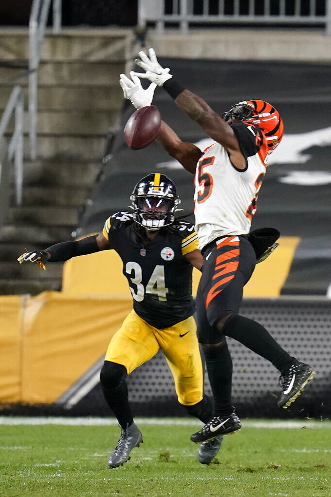 Cincinnati Bengals running back Giovani Bernard (25) cannot come down with a pass with Pittsburgh Steelers strong safety Terrell Edmunds (34) defending during the second half of an NFL football game, Sunday, Nov. 15, 2020, in Pittsburgh. (AP Photo/Keith Srakocic)
