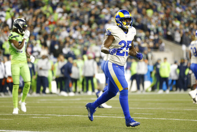 Los Angeles Rams running back Sony Michel (25) reacts after he scored a touchdown against the Los Angeles Rams during the second half of an NFL football game, Thursday, Oct. 7, 2021, in Seattle. (AP Photo/Craig Mitchelldyer)