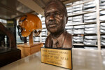An Eddie Robinson Coach of the Year award is displayed at the College Football Hall of Fame, Thursday, Sept. 2, 2021, in Atlanta. The Hall has a new exhibit new exhibit dedicated to historically black colleges and universities. (AP Photo/John Bazemore)