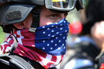 FILE - In this Aug. 4, 2018, file photo, a protester participates in a rally in Portland, Ore. Portland police are mobilizing in hopes of avoiding clashes between out-of-state hate groups planning a rally Saturday, Aug. 17, 2019, and homegrown anti-fascists who say they'll come out to oppose them. (Mark Graves/The Oregonian via AP, File)