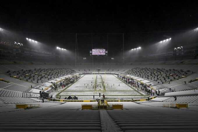 The seats in the end zone are empty at Lambeau Field before an NFL football game between the Green Bay Packers and the Tennessee Titans Sunday, Dec. 27, 2020, in Green Bay, Wis. (AP Photo/Morry Gash)