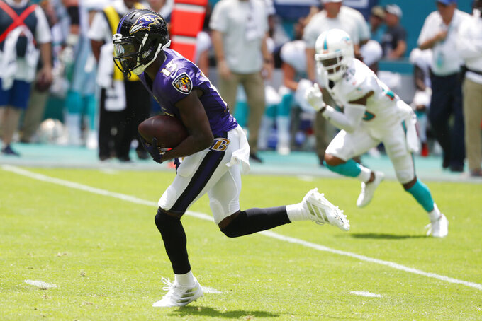 Baltimore Ravens wide receiver Marquise Brown (15) runs for a touchdown, during the first half at an NFL football game against the Miami Dolphins, Sunday, Sept. 8, 2019, in Miami Gardens, Fla. (AP Photo/Wilfredo Lee)