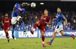 Napoli's Kalidou Koulibaly, left, heads the ball as Liverpool's Roberto Firmino tries to stop him during the Champions League Group E soccer match between Napoli and Liverpool, at the San Paolo stadium in Naples, Italy, Tuesday, Sept. 17, 2019. (AP Photo/Gregorio Borgia)
