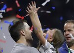 New England Patriots' Tom Brady holds his daughter, Vivian, after the NFL Super Bowl 53 football game against the Los Angeles Rams, Sunday, Feb. 3, 2019, in Atlanta. The Patriots won 13-3. (AP Photo/John Bazemore)