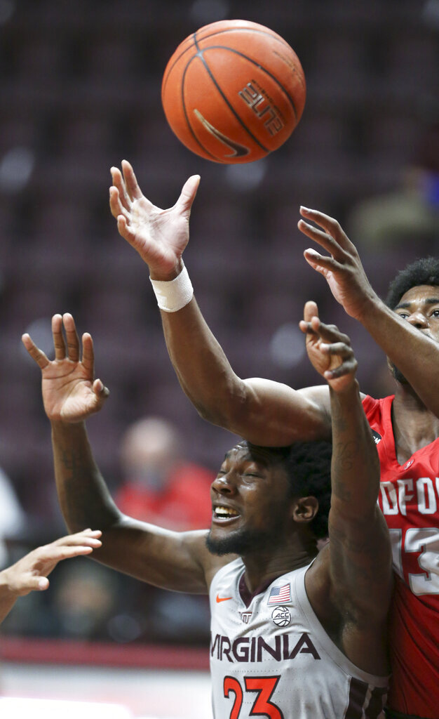 Virginia Tech's Tyrece Radford (22) and Radford Shaquan Jules (13) reach for a rebound in the second half of an NCAA college basketball game, Wednesday Nov. 25, 2020, in Blacksburg Va. (Matt Gentry/The Roanoke Times via AP)