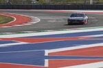 FILE - In this Oct. 31, 2019, file photo, Haas Formula 1 drivers Romain Grosjean, of France, and Kevin Magnussen, of Denmark, drive a NASCAR Cup Series car owned by Stewart-Haas Racing at the Formula One U.S. Grand Prix auto race at the Circuit of the Americas in Austin, Texas. After several years of competing on the racing calendar with F1's annual stop in Austin, NASCAR brings stock car racing to a new road course where the drivers say they're excited to bump their way through the turns and s-curves carved out of rolling scrub land of Central Texas. (AP Photo/Darron Cummings, File)