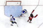 New Jersey Devils right wing Joey Anderson (49) celebrates after scoring a goal as St. Louis Blues goaltender Jake Allen (34) and defenseman Robert Bortuzzo (41) look on during the second period of an NHL hockey game, Saturday, March 30, 2019, in Newark, N.J. (AP Photo/Julio Cortez)