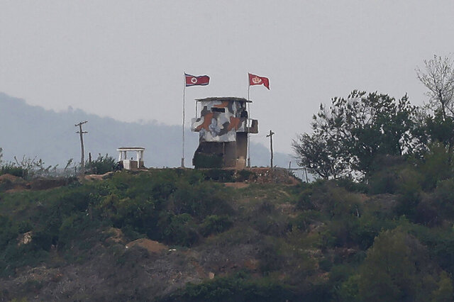 FILE - In this May 3, 2020, file photo, a North Korean flag flutters in the wind at a military guard post in Paju, at the border with North Korea. North Korea on Friday, May 8, slammed South Korea for staging what it called