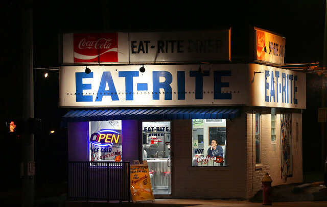 Eat-Rite Diner's Sarah Williams had cooked for only two take-out customers by nightfall in downtown St. Louis on Wednesday, March 18, 2020.