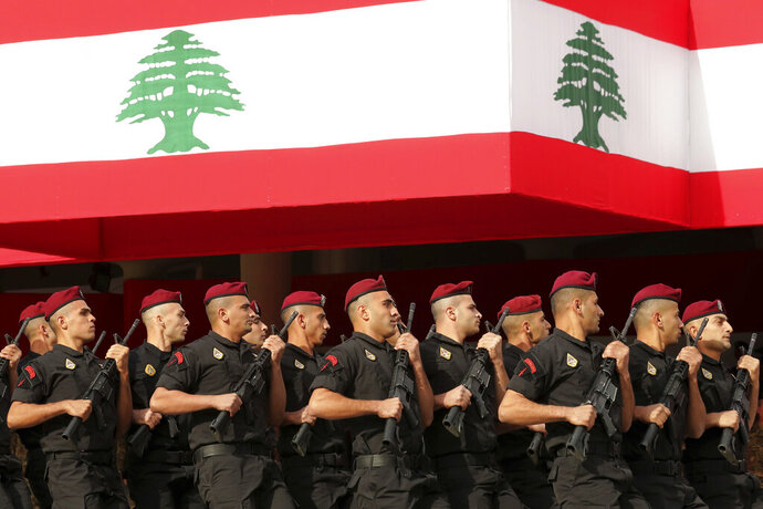 Lebanese marine special forces soldiers march during a military parade to mark the 76th anniversary of Lebanon's independence from France at the Lebanese Defense Ministry, in Yarzeh near Beirut, Lebanon, Friday, Nov. 22, 2019. Lebanon's top politicians attended Friday a military parade on the country's 76th Independence Day, appearing for the first time since the government resigned amid nationwide protests now in their second month. (AP Photo/Hassan Ammar)