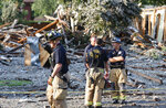 Plano emergency personnel work the scene after a home exploded at about 4:45 p.m. in the 4400 block of Cleveland Drive in Plano, Texas, Monday, July 19, 2021. (Stewart F. House/The Dallas Morning News via AP)