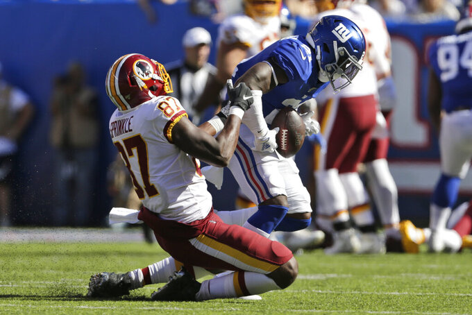 New York Giants' Jabrill Peppers, right, intercepts a pass intended for Washington Redskins' Jeremy Sprinkle (87) during the second half of an NFL football game, Sunday, Sept. 29, 2019, in East Rutherford, N.J. (AP Photo/Adam Hunger)