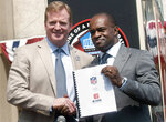 FILE - In this Aug. 5, 2011, file photo, NFL Comissioner Roger Goodell, left, and NFLPA Executive Director DeMaurice Smith shake hands after signing their collective bargaining agreement at the Pro Football Hall of Fame in Canton, Ohio. Ron Mix likes what he has seen and read regarding the new labor agreement between the NFL and its players from the deal struck last month that runs through the 2030 season. Mix, a Pro Football Hall of Famer, board member with the Pro Football Retired Players Association and retired attorney, praises NFL Commissioner Roger Goodell and NFLPA Executive Director DeMaurice Smith for their commitment to helping the retirees.   (AP Photo/Phil Long, File)