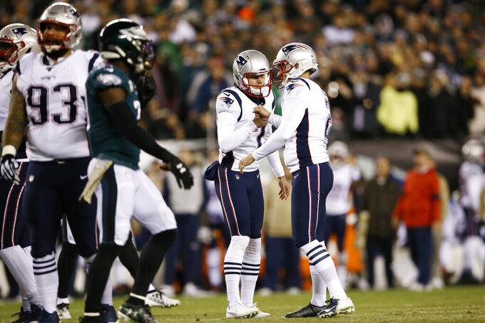 New England Patriots' Nick Folk (2) and Jake Bailey (7) celebrate after Folk's field goal during the first half of an NFL football game against the Philadelphia Eagles, Sunday, Nov. 17, 2019, in Philadelphia. (AP Photo/Michael Perez)