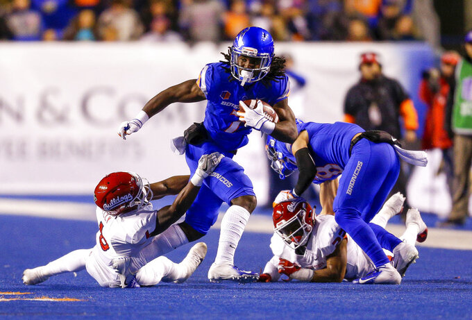 Boise State wide receiver A.J. Richardson (7) tries to break away from a Fresno State defender after a reception during the first half of an NCAA college football game Friday, Nov. 9, 2018, in Boise, Idaho. (AP Photo/Steve Conner)