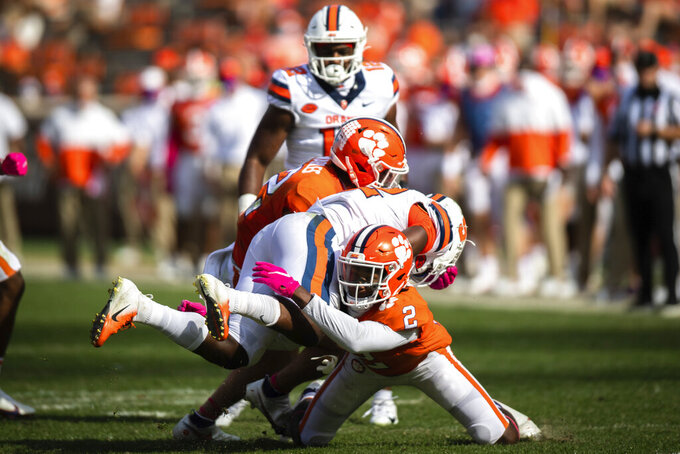 Syracuse running back Markenzy Pierre (22) is tackled by Clemson cornerback Fred Davis II (2) during an NCAA college football game in Clemson, S.C., on Saturday, Oct. 24, 2020. (Ken Ruinard/Pool Photo via AP)