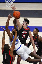 Pittsburgh's Gerald Drumgoole Jr. (4) soots as he slices in front of defending St. Francis' Josh Cohen (33) during the first half of an NCAA college basketball game, Wednesday, Nov. 25, 2020, in Pittsburgh. (AP Photo/Keith Srakocic)