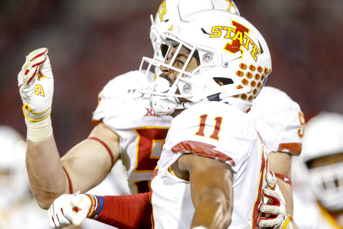 Iowa State Cyclones defensive back Lawrence White (11) celebrates after a late fourth quarter interception during the NCAA football game between the against the Iowa State Cyclones and the Oklahoma Sooners at Gaylord Family-Oklahoma Memorial Stadium in Norman, Okla., on Saturday, Nov. 9, 2019. (Ian Maule/Tulsa World via AP)