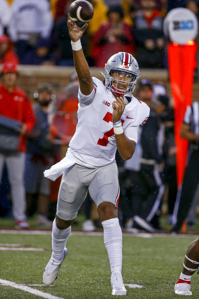 Ohio State quarterback C.J. Stroud throws a pass against Minnesota during the first quarter of an NCAA college football game Thursday, Sept. 2, 2021, in Minneapolis. (AP Photo/Bruce Kluckhohn)