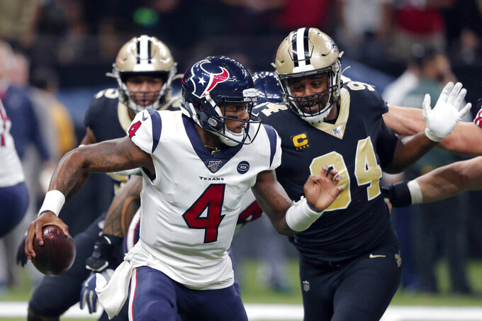 Houston Texans quarterback Deshaun Watson (4) scrambles as New Orleans Saints defensive end Cameron Jordan (94) pursues in the first half of an NFL football game in New Orleans, Monday, Sept. 9, 2019. (AP Photo/Bill Feig)