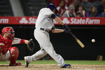 Milwaukee Brewers' Mike Moustakas hits a two-run home run during the fifth inning of the team's baseball game against the Los Angeles Angels, Tuesday, April 9, 2019, in Anaheim, Calif. (AP Photo/Jae C. Hong)