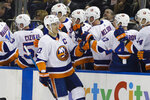 New York Islanders' Anders Lee (27) celebrates with teammates after scoring during the second period of an NHL hockey game against the New York Rangers Tuesday, Jan. 21, 2020, in New York. (AP Photo/Frank Franklin II)