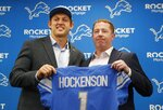 Detroit Lions first-round draft pick T.J. Hockenson, left, stands with team general manager Bob Quinn at the NFL football team's training facility, Friday, April 26, 2019, in Allen Park, Mich. (AP Photo/Carlos Osorio)