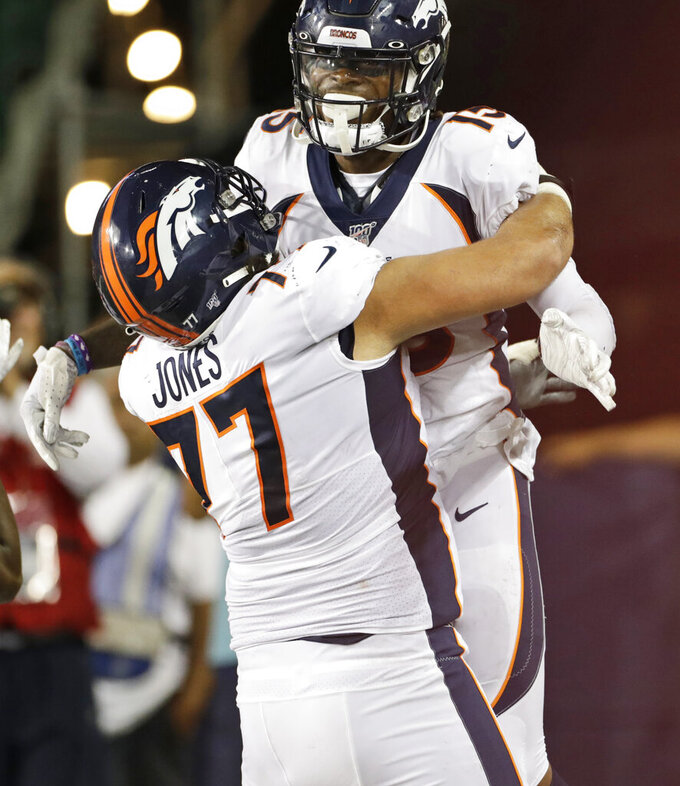 Denver Broncos wide receiver Juwann Winfree (15) celebrates a touchdown with offensive guard Sam Jones (77) during the second half of the team's Pro Football Hall of Fame NFL preseason game against the Atlanta Falcons, Thursday, Aug. 1, 2019, in Canton, Ohio. The Broncos won 14-10. (AP Photo/Ron Schwane)