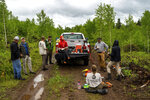 In this June 24, 2019, photo Emily Krulc, center, and her Minnesota Conservation Corps crew take a lunch break while planting white pine seedlings in the Moose Creek area near Schroeder, Minn. (Evan Frost/Minnesota Public Radio via AP)