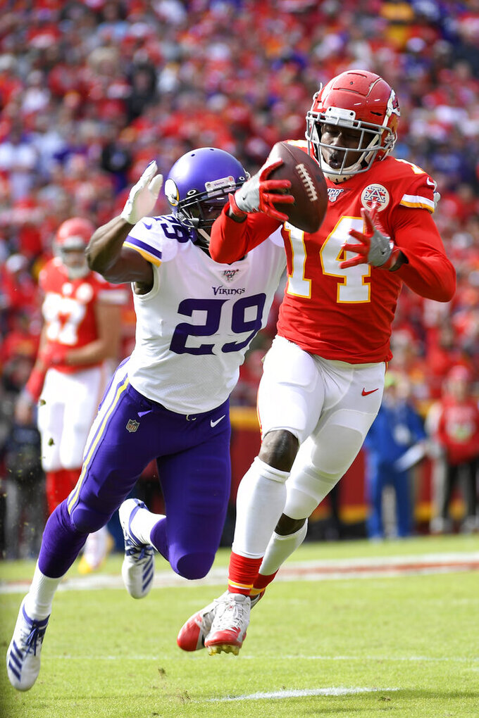 Kansas City Chiefs wide receiver Sammy Watkins (14) makes a catch against the defense of Minnesota Vikings cornerback Xavier Rhodes (29), during the first half of an NFL football game in Kansas City, Mo., Sunday, Nov. 3, 2019. (AP Photo/Reed Hoffmann)